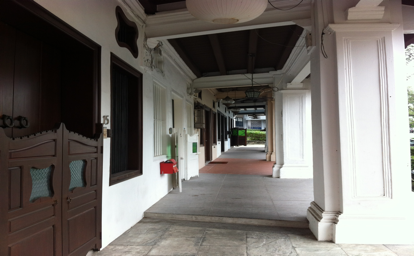 Corridor of shop houses with glazed doors and modern tiles