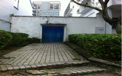 The old metal side gate, now covered with a blue plastic sheet